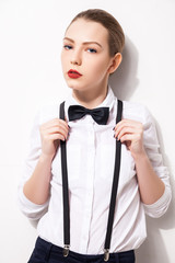 Elegant young woman holding her bow tie