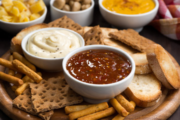 assortment delicious appetizers with sauces