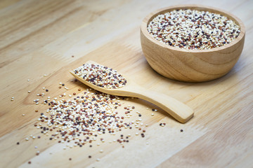 Tri-color Quinoa Super food on wood dish and wood spoon