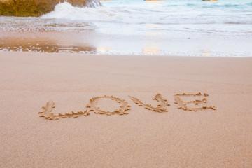 Napis na piasku miłość, kocham, Portugalia