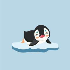 A cute little penguin on a bit of ice.