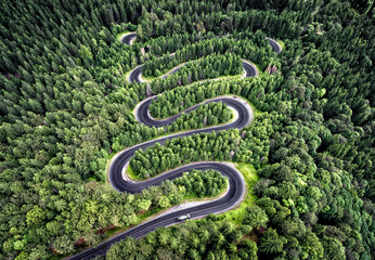 Curvy road from the high mountain pass in Transalpina, Romania.