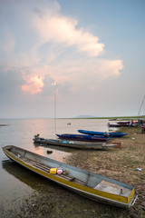 sunset on the sea with a boat at Bangpra beach chonburi,thailand