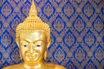 Buddha gold statue on blue background patterns Thailand.