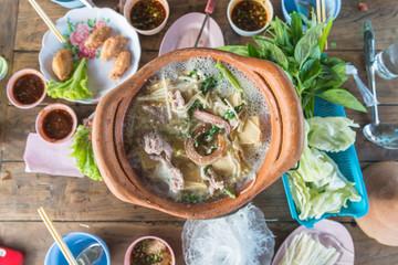 clay pot.Thai traditional spicy shabu shabu, dipping meat in boi