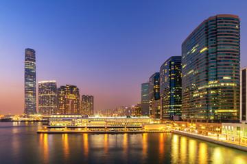 Beautiful Building in Hong Kong at night and Victoria Harbor vie