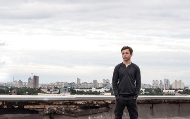 teenager on the roof of a tall building