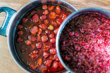 Strawberry and raspberry jam in a saucepan