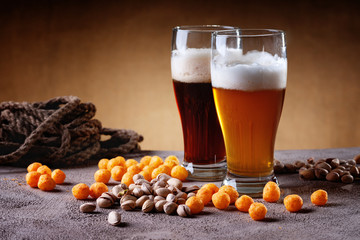 Glasses of beer, rope, cheese balls and pistachio nuts