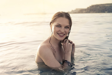 Smiling woman in the water