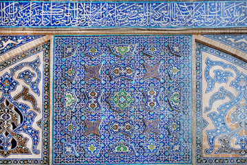 Old tiled design with traditional Persian patterns on wall