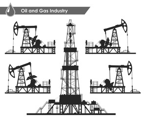 Set of oil pumps and rig silhouettes