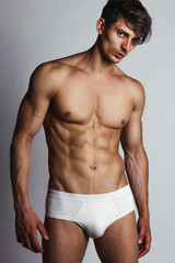 Male swimwear & underwear concept. Handsome muscular male model