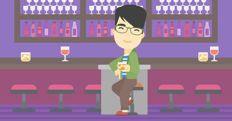 Man sitting at the bar counter.