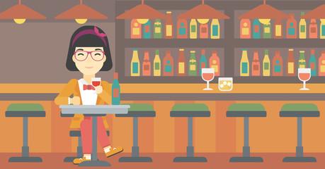 Woman drinking wine at restaurant.