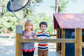Portrait of cute girl and boy at the playground