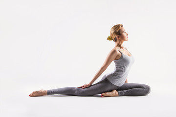 Beautiful young woman doing yoga. Isolated on white