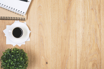Wooden desk with coffee