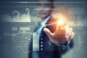 Businessman using innovative technologies . Mixed media