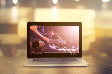 Video player of live concert guitarist on stage, all on laptop are designed up