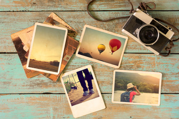Photo album remembrance and nostalgia in summer journey trip on wood table. instant photo of vintage camera - vintage and retro style Wall mural