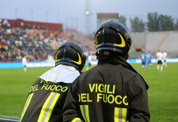 two Italian firefighters with uniform with the inscription FIREF