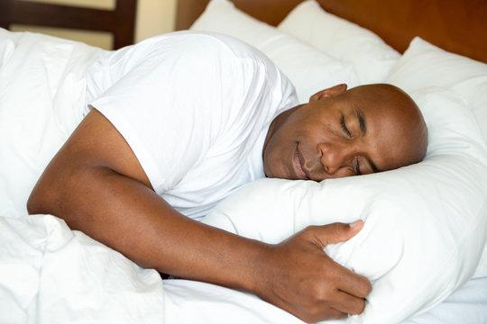African American man sleeping.