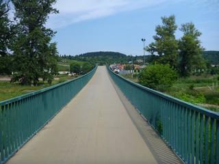 pedestrian bridge with green railing