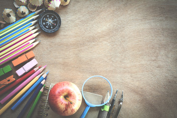 Top view set school supplies on a wooden table with copy space. Back to school