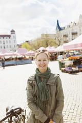 Portrait of happy mature woman in market