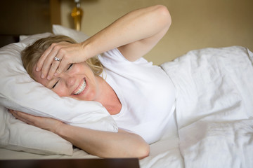 Happy woman had a good nights rest.