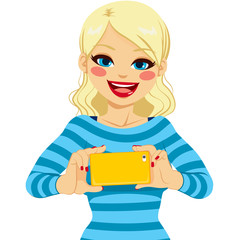 Beautiful blonde woman happy smiling having fun taking photos with smartphone