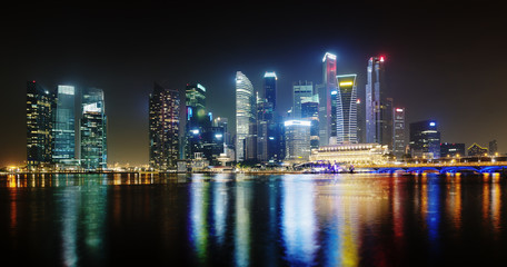 Night Singapore skyscrapers shines with lights