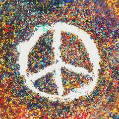 Peace symbol on scraps of colorful pastel oil colors