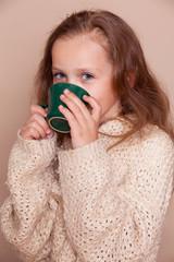 little girl with green tea