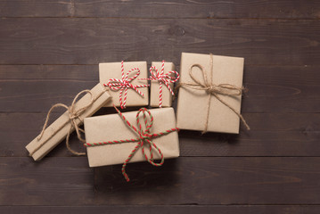 Gift boxes are on the wooden background with empty space