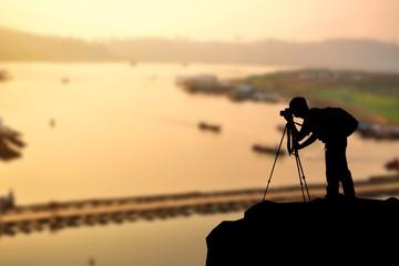 Silhouette man photographer