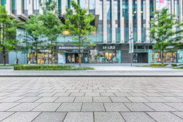 Fototapete - Empty brick floor with modern building in Shanghai