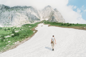 Man walking on snow in the mountains