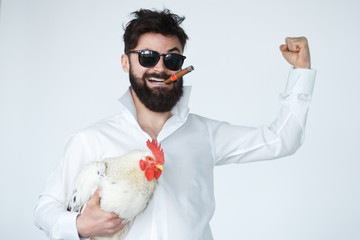 Bearded Man holding Thai Fight cock
