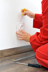 Electrician fixing socket electricity problem