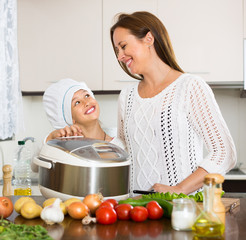 Girl and her mom with rice cooker