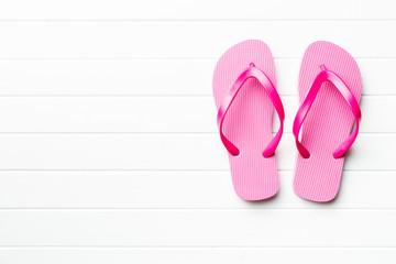 Pink flop flops.