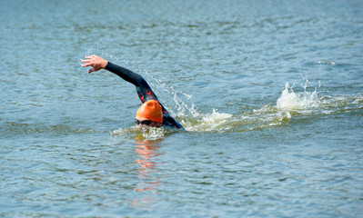 Young man swimming in race.