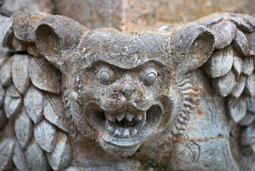 Muzzle fantastic beast on the wall of an old Indonesian temple