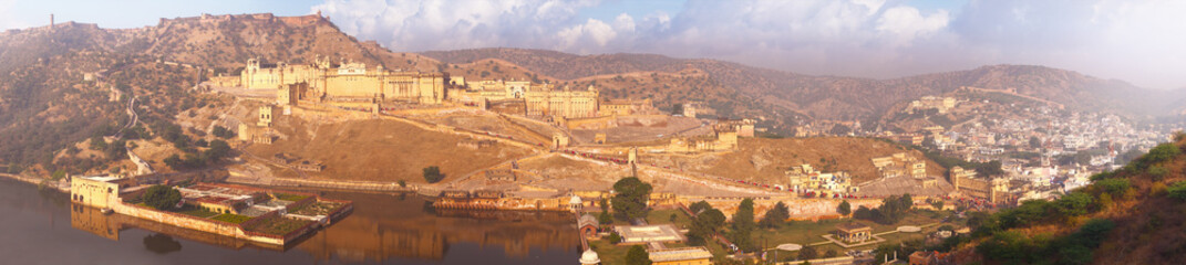 Indian landmarks - panorama with Amber fort, lake and the city.