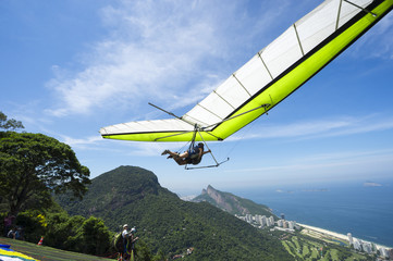 Hangglider taking off from the ramp at Pedra Bonita, in the Tijuca National Forest, heading toward the beach at São Conrado in Rio de Janeiro, Brazil