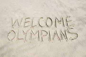 Welcome Olympians message handwritten in smooth sand on the beach in Rio de Janeiro, Brazil