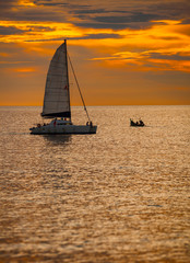 Catamaran Sailboat on a Tropical Sea at Sunset