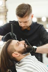 Barber making beard form for man